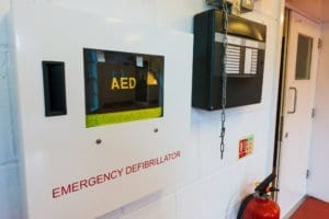 AED (Automated Extenal Defibrillator) - Heart defibrillator hanging on the wall in school prepared to provide life-saving treatment