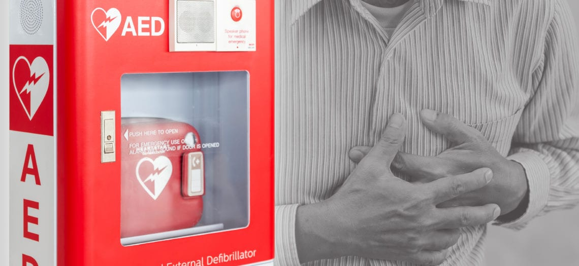 Automatic External Defibrillator (AED) hanging on wall